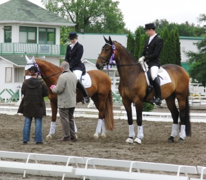 William and Lindsey accepting 2nd place from Axel Steiner, 76.2%,FEI 5 yr old, Prelim