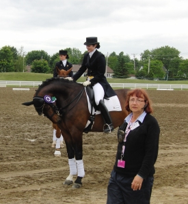 A familar face in Montreal, our FEI steward from Alberta, Linda Miller, (and Lance trying to chew his ribbon)