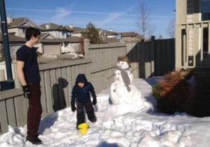 Greg and Mack, snowman building at Easter dinner at Mongomery's