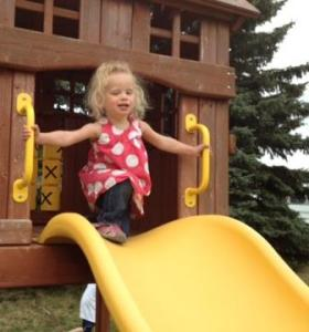 "Calie loves to climb. She just needs help at the bottom of the slide.  ""Wheeeeee"""