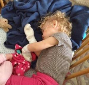 Nap time after the Museum.  She took her fleece off and put both socks on her hands.  Papa thinks she had a puppet show in her crib.  Funny baby....