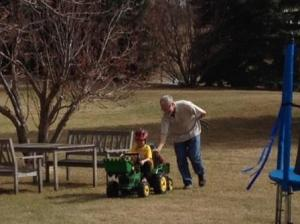 """Thanks Papa!  It's hard to pedal on the lawn!!"""