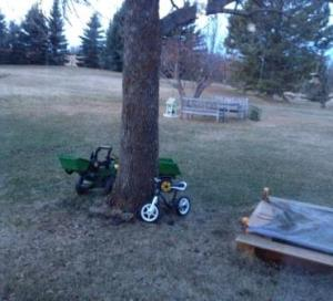 The John Deere and bike parked after a long play day yesterday.