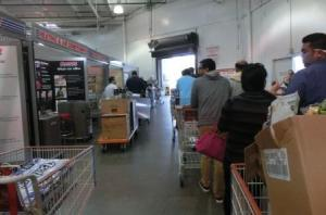 And of course...we're totally crazy and went to Costco.  No parking spaces (everyone had line up to wait till someone vacated a spot).  This is the middle of the line to get out the door to leave!!!