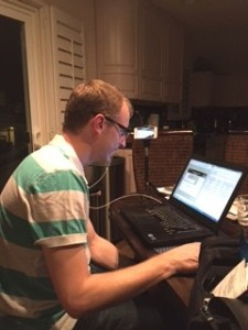 """While the girls slog away on web design, Neil is """"working from home"""".  (note the selfie stick on a tripod...Edmonton is playing at home...)"""